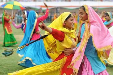 Indian school girls perform the traditional Punjabi 'giddha dance' during Independence Day celebrations.