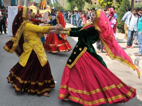 Women celebrating Lohri